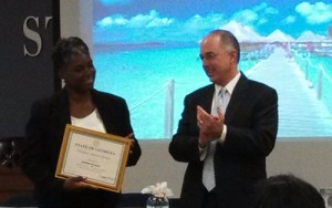 Sherma Francis accepts a certificate commemorating her career of service from DOAS Commissioner Sid Johnson.
